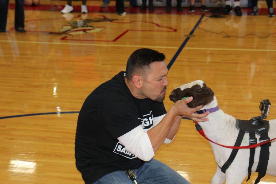 Last year's Kiss the Goat winner, principal Fernando Benavides. Photo by senior Zanidia Johnson.
