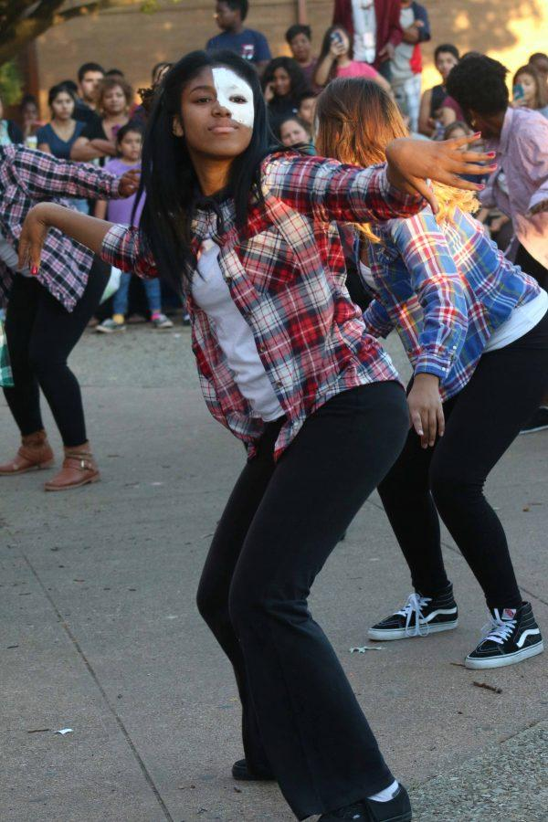 SHHS dance club member performs Thriller at last year's Science Night event in the courtyard. Photo by senior Sonia Olvera.