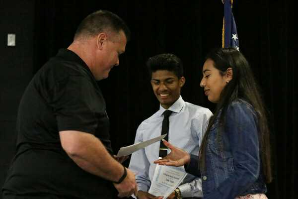 Senior varsity soccer players Luis Vargas and Guadalupe Vazquez earned full scholarships to Paris Junior College and Cisco Junior College. The pair were recognized for their achievements April 19 in the Little Theather. Photo by junior Bithia Dantoumda.