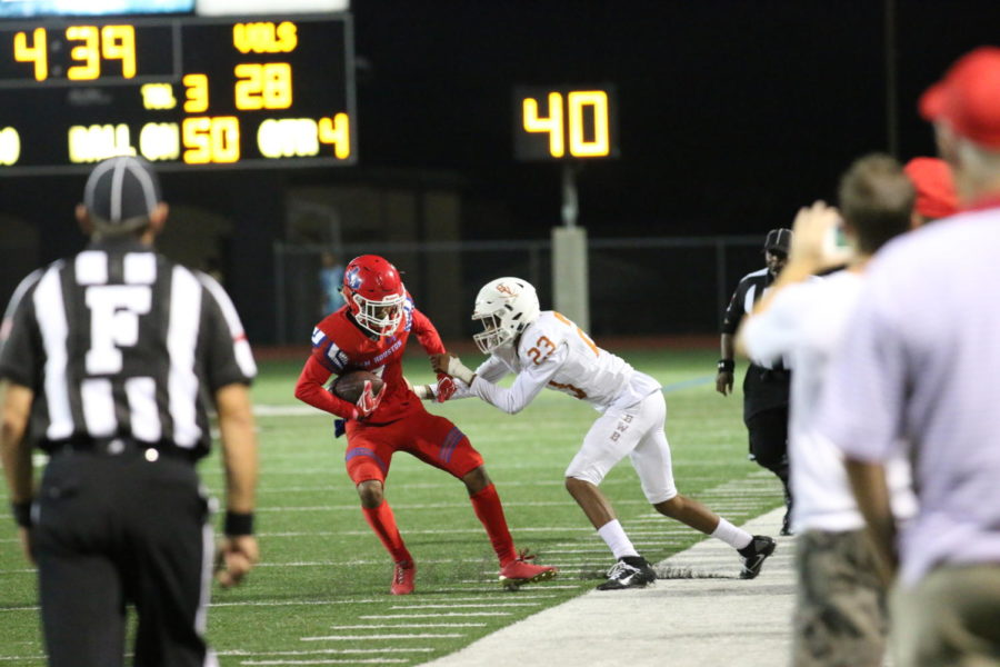 Senior Joshua Bolden attempt to dodge a Bowie player in a game Oct. 5.